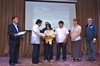Mr. Andres Baaco III  and Ms. Virginia Catain receive the award for 1Lt. Andres Baaco Sr..JPG