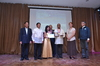 Mr. Carlo Amores and Ms. Coleen Joyce Amores receive the award for Capt. Carlos Amores.JPG